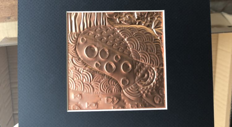 copper embossed zentangle in a black frame